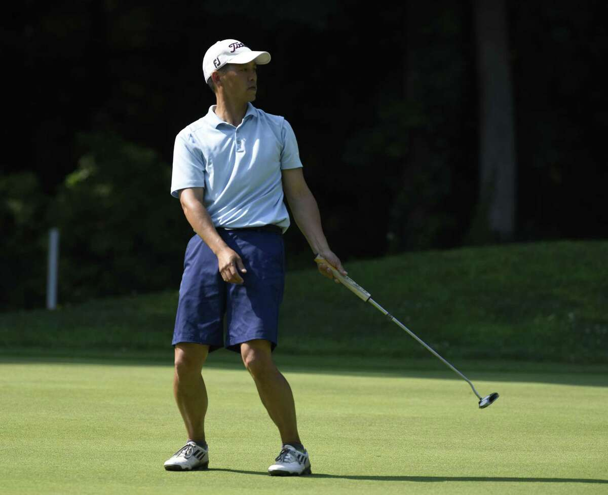 David Peng reacts to his putt in the Greenwich Townwide Men's Golf Tournament at the Griffith E. Harris Golf Course in Greenwich, Conn. Sunday, June 26, 2016. Peng won the tournament with a two-day score of 149.