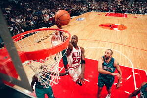 CHICAGO, IL - MAY 6:  Michael Jordan of the Chicago Bulls takes the ball to the basket during the game against the Charlotte Hornets on May 6, 1998 at United Center in Chicago, Illinois. (Photo by Sporting News via Getty Images)