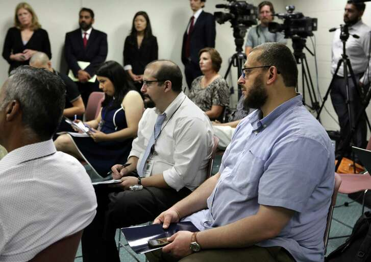 Imam Osama Hassan of the Victoria Islamic Center, right, listens as Abe Martinez, the Acting U.S. Attorney addresses the media during a press conference in Victoria, Tx, on Thursday, June 22, 2017. Martinez announced that Marq Perez, 25, of Victoria, has been indicted for allegedly burning the Victoria Islamic Center on Jan. 28, 2017.