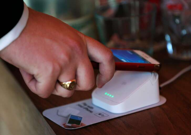 Kyle Schoonhoven uses Apple Pay to pay for his drink in Ritual Coffee off of Octavia St. June 20, 2017 in San Francisco, Calif.