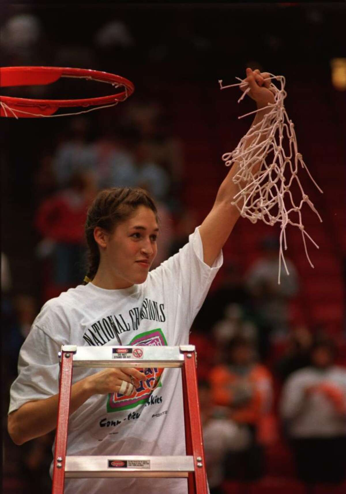 2 Apr 1995: MVP REBECCA LOBO OF THE CONNECTICUT HUSKIES HOLDS UP THE NET AFTER CUTTING IT FROM THE RIM IN CELEBRATION OF HER TEAM WINNING THE NATIONAL CHAMPIONSHIP OF THE WOMEN''S NCAA FINAL AT THE TARGET CENTER IN MINNEAPOLIS, MINNESOTA. CONNECTICUT DEFEA