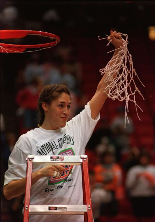 2 Apr 1995: MVP REBECCA LOBO OF THE CONNECTICUT HUSKIES HOLDS UP THE NET AFTER CUTTING IT FROM THE RIM IN CELEBRATION OF HER TEAM WINNING THE NATIONAL CHAMPIONSHIP OF THE WOMEN''S NCAA FINAL AT THE TARGET CENTER IN MINNEAPOLIS, MINNESOTA. CONNECTICUT DEFEA Photo: Jonathan Daniel, Getty Images / Getty Images North America