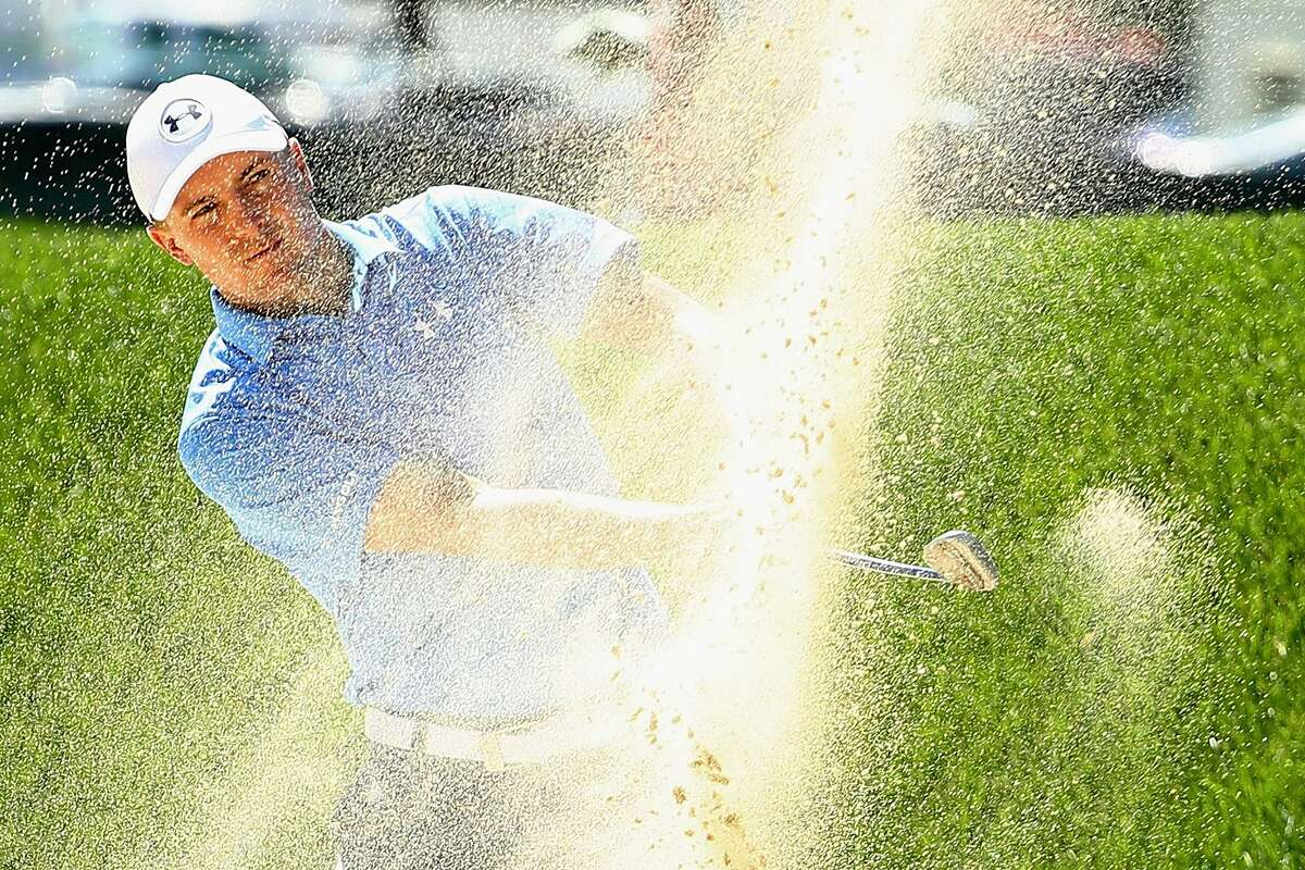 Jordan Spieth of the United States plays a shot from a bunker on the ninth hole during the first round of the Travelers Championship Thursday at TPC River Highlands in Cromwell.