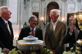 PGA of America President Ted Bishop, left, San Francisco Mayor Ed Lee, second from left, former United States Golf Association President Sandy Tatum, second from right, and PGA Tour Commissioner Tim Finchem, right, share a laugh on Wednesday, July 2, 2014 after a press conference at City Hall announcing three high-profile golf events, the 2015 Match Play Championship, the 2020 PGA Championship and the 2025 Presidents Cup, will be coming to TPC Harding Park in San Francisco, Calif. Tatum, who turns 94 this month, helped lead a campaign to renovate Harding Park in the early 2000s.