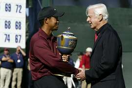 AMEXgolf_0039_db.jpg Tiger Woods shakes hands with Sandy Tatum (Honorary Chairman) as he holds the trophy after winning the American Express Championship at Harding Park Golf Course. Event on 10/9/05 in San Francisco. Darryl Bush / The Chronicle Ran on: 06-11-2006 Sandy Tatum (right), with Tiger Woods after 2005 American Express Championship, defended Winged Foot's difficulty in 1974. Ran on: 06-11-2006 Sandy Tatum (right), with Tiger Woods after 2005 American Express Championship, defended Winged Foot's difficulty in 1974. Ran on: 06-11-2006