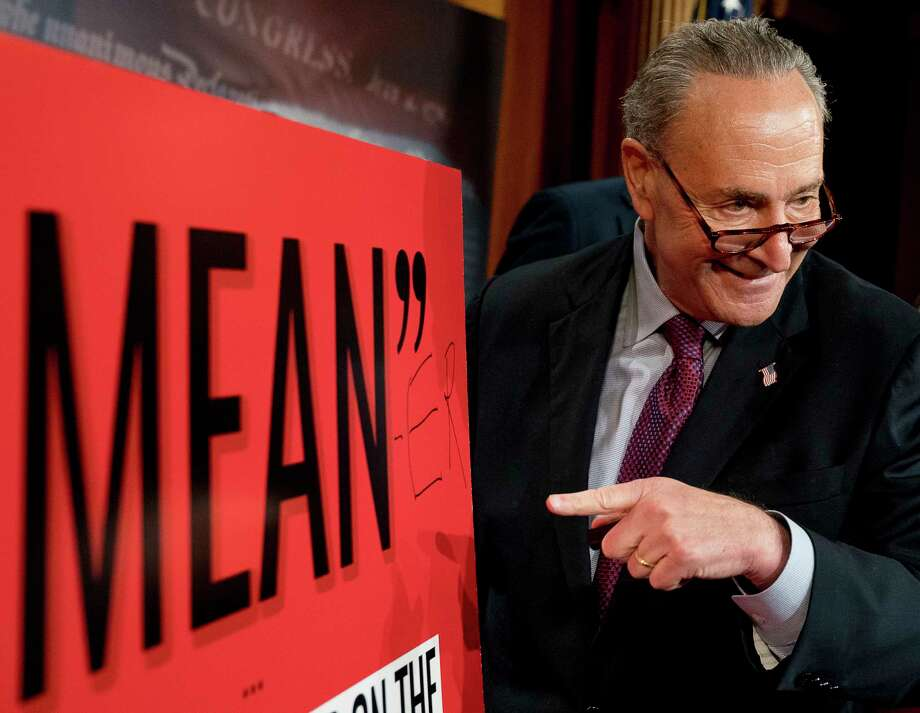 """Senate Minority Leader Chuck Schumer, D-N.Y., writes """"Mean-er"""" on a reported quote by President Donald Trump as Schumer responds to the release of the Republicans' healthcare bill which represents the long-awaited attempt to scuttle much of President Barack Obama's Affordable Care Act, at the Capitol in Washington, Thursday, June 22, 2017. (AP Photo/Andrew Harnik) ORG XMIT: DCAH113 Photo: Andrew Harnik / Associated Press"""