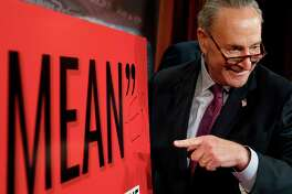 """Senate Minority Leader Chuck Schumer, D-N.Y., writes """"Mean-er"""" on a reported quote by President Donald Trump as Schumer responds to the release of the Republicans' healthcare bill which represents the long-awaited attempt to scuttle much of President Barack Obama's Affordable Care Act, at the Capitol in Washington, Thursday, June 22, 2017. (AP Photo/Andrew Harnik) ORG XMIT: DCAH113"""