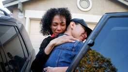 Sandra Salazar hugs her oldest daughter Citlalli after the family moved out of their home in Fairfield, Calif. on Wednesday, June 14, 2017. Salazar and one of her three daughters are relocating to Mexico to live with her husband and the daughters' father who lost his U.S. immigration status and forced to return to his home country while Salazar's oldest daughter Citlalli will remain in California.