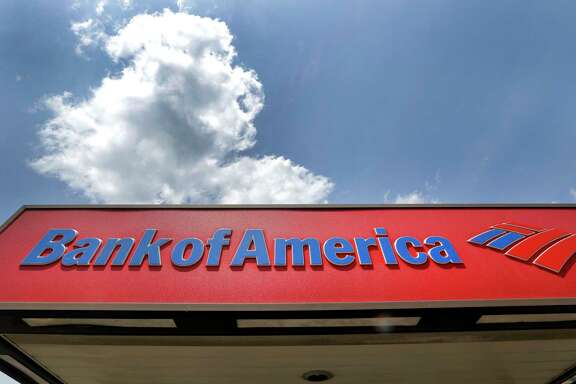 FILE - This Monday, July 18, 2016, file photo shows the top of a Bank of America ATM booth, in Woburn, Mass. On Thursday, June 22, 2017, the Federal Reserve said all of the 34 largest U.S. banks are fortified enough to withstand a severe U.S. and global recession and continue lending. The banks undergoing the seventh annual check-up included JPMorgan Chase & Co., Bank of America Corp., Citigroup Inc. and Wells Fargo and Co., which are the four biggest U.S. banks by assets. (AP Photo/Elise Amendola, File)