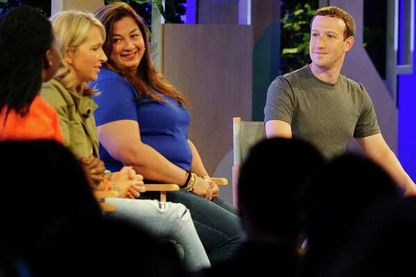 """Facebook CEO Mark Zuckerberg meets with panelists at a Facebook """"communities summit"""" Thursday in Chicago. He announced an initiative designed to spur people to form more meaningful communities."""