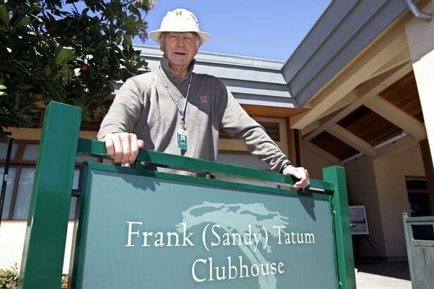 Sandy Tatum poses at the clubhouse which is named after him, during a practice round for the American Express World Golf Championships at Harding Park in San Francisco, Tuesday, Oct. 4, 2005. Just about everyone looked at Harding Park as a golf course that was simply taking up valuable property. Sandy Tatum saw a gem. The public course along Lake Merced will host Tiger Woods, Phil Mickelson and an elite field in the American Express Championship. It is another example of how municipal courses are worthy of hosting the best in the world. Tatum simply hopes other courses are paying attention.(AP Photo/Eric Risberg)