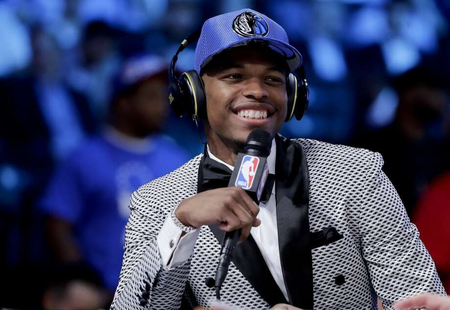 Dennis Smith Jr. answers questions during an interview after being selected by the Dallas Mavericks as the ninth pick overall during the NBA basketball draft, Thursday, June 22, 2017, in New York. (AP Photo/Frank Franklin II) Photo: Frank Franklin II/Associated Press
