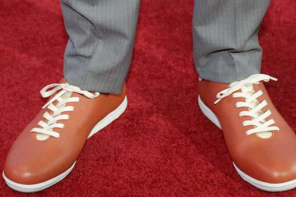 Washington's Markelle Fultz, wearing basketball-themed shoes, poses for photos on the red carpet before the start of the NBA basketball draft, Thursday, June 22, 2017, in New York. (AP Photo/Frank Franklin II)