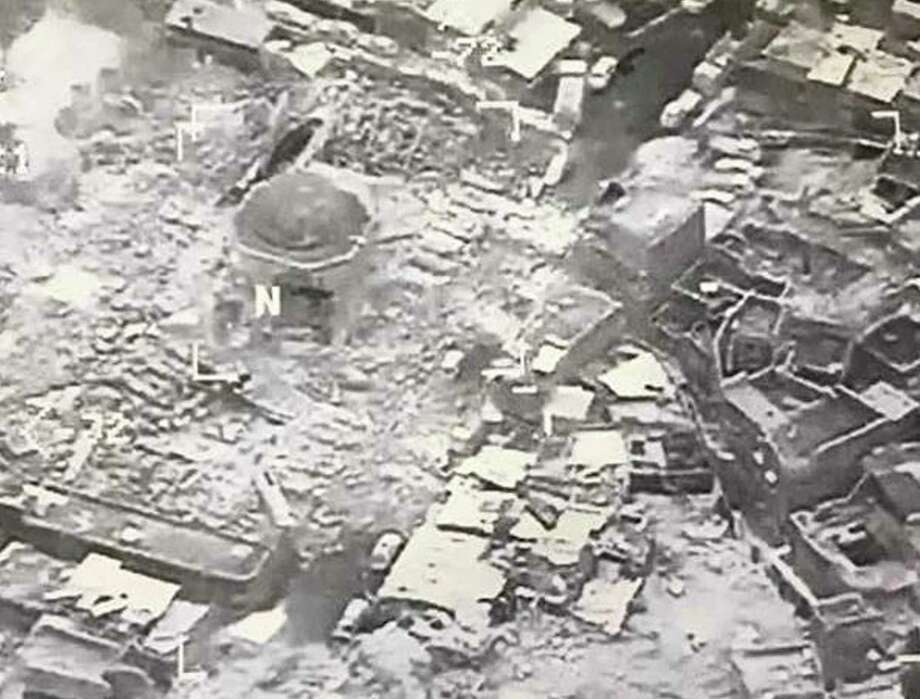 This image provided by U.S. CENTCOM shows al-Nuri mosque destroyed by the Islamic State group, in Mosul, Iraq, Wednesday, June 21, 2017. The Islamic State group destroyed the mosque and its iconic leaning minaret known as al-Hadba when fighters detonated explosives inside the structures Wednesday night, Iraq's Ministry of Defense said. Iraqi Prime Minister Haider al-Abadi tweeted early Thursday, June 22, 2017 that the destruction was an admission by the militants that they are losing the fight for Iraq's second-largest city. (U.S. CENTCOM via AP) ORG XMIT: TKTT101 / US CENTCOM