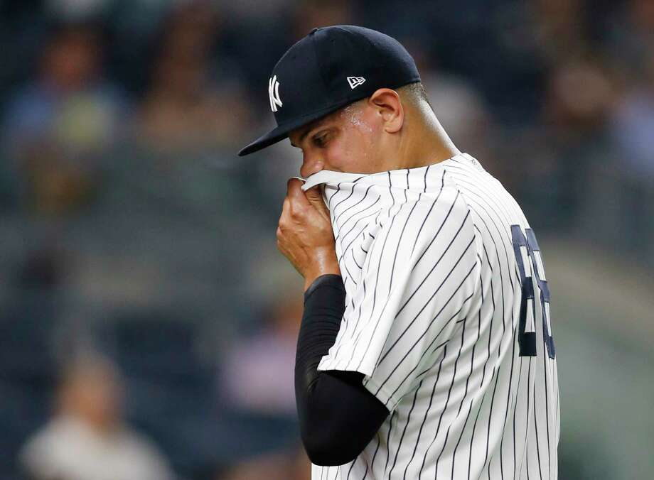 New York Yankees relief pitcher Dellin Betances wipes his face on his jersey while leaving the mound after allowing two runs during the seventh inning of the team's baseball game against the Los Angeles Angels in New York, Thursday, June 22, 2017. (AP Photo/Kathy Willens) ORG XMIT: NYY122 Photo: Kathy Willens / Copyright 2017 The Associated Press. All rights reserved.