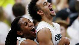 FILE - In this Jan. 28, 2017, file photo, Colorado guard Xavier Johnson, left, hoists guard Derrick White at the end of the team's NCAA college basketball game against Oregon in Boulder, Colo. Colorado won 74-65. The San Antonio Spurs selected White with the 29th pick in the NBA draft Thursday, June 22. (AP Photo/David Zalubowsk, File))