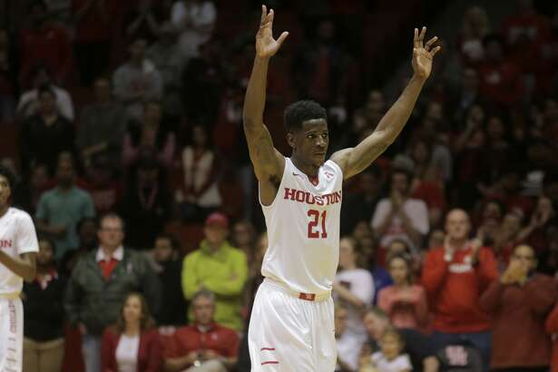 Houston Cougars guard Damyean Dotson (21) raises up his hands as he leave the court for the last time  at Hofheinz Pavilion on Sunday, March 5, 2017, in Houston. Houston won the game 73-51.( Elizabeth Conley / Houston Chronicle )