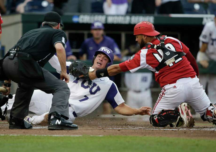 TCU's Josh Watson (7) is safe at home before the tag by Louisville catcher Colby Fitch during the second inning of an NCAA College World Series baseball game in Omaha, Neb., Thursday, June 22, 2017. (AP Photo/Nati Harnik) ORG XMIT: NENH102 Photo: Nati Harnik / Copyright 2017 The Associated Press. All rights reserved.