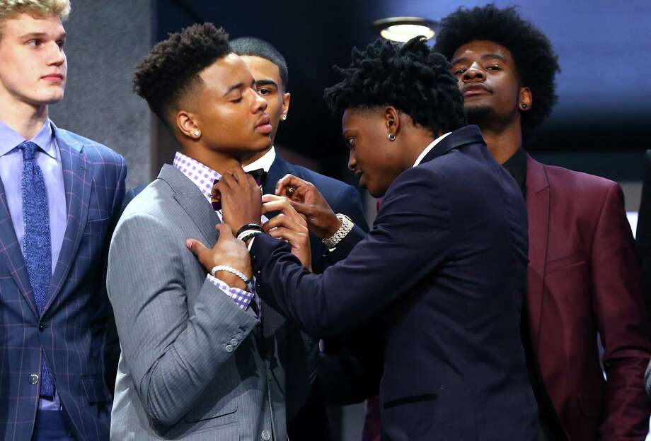 NEW YORK, NY - JUNE 22: De'Aaron Fox helps adjust the bowtie of Markelle Fultz before the first round of the 2017 NBA Draft at Barclays Center on June 22, 2017 in New York City. NOTE TO USER: User expressly acknowledges and agrees that, by downloading and or using this photograph, User is consenting to the terms and conditions of the Getty Images License Agreement.  (Photo by Mike Stobe/Getty Images) ORG XMIT: 700017610 Photo: Mike Stobe / 2017 Getty Images
