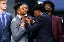 NEW YORK, NY - JUNE 22: De'Aaron Fox helps adjust the bowtie of Markelle Fultz before the first round of the 2017 NBA Draft at Barclays Center on June 22, 2017 in New York City. NOTE TO USER: User expressly acknowledges and agrees that, by downloading and or using this photograph, User is consenting to the terms and conditions of the Getty Images License Agreement.  (Photo by Mike Stobe/Getty Images) ORG XMIT: 700017610