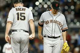 ATLANTA, GA - JUNE 22:  Manager Bruce Bochy #15 of the San Francisco Giants takes the ball from pitcher Matt Cain #18 in the fifth inning during the game against the Atlanta Braves at SunTrust Park on June 22, 2017 in Atlanta, Georgia.  (Photo by Mike Zarrilli/Getty Images)