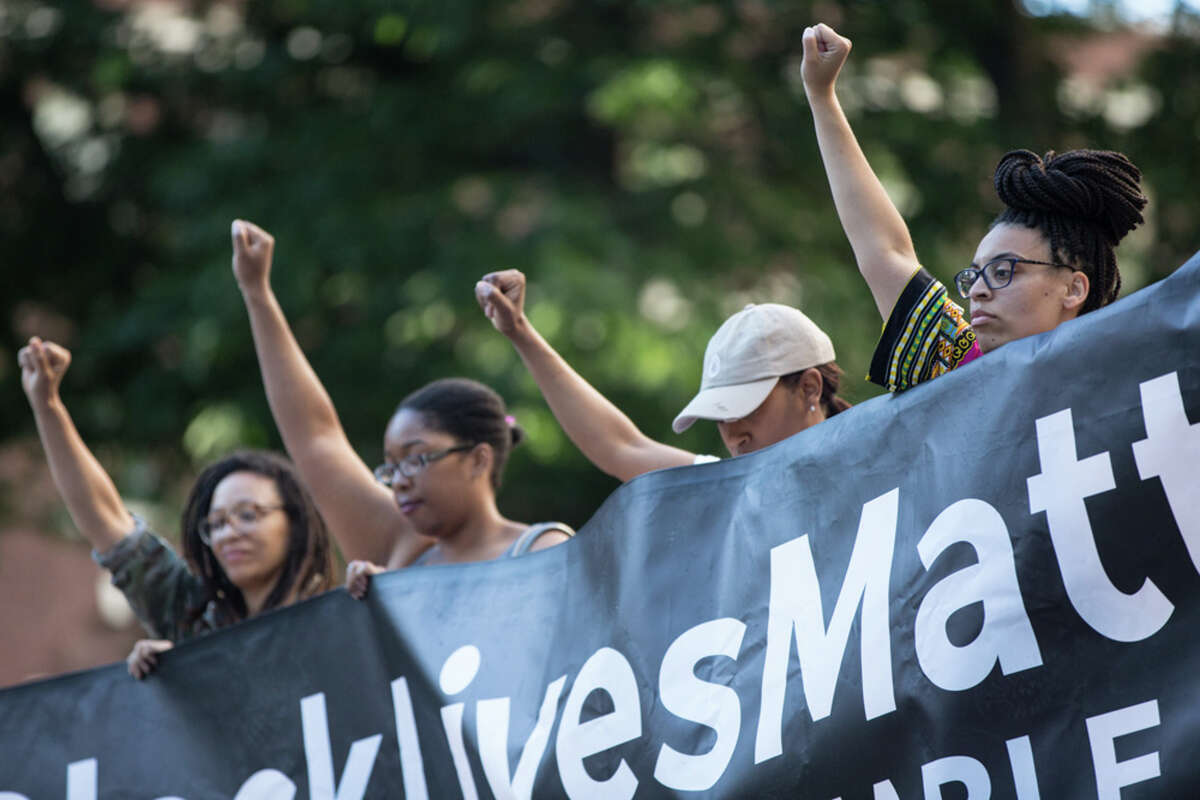 Protesters show their support for Black Lives Matter in front of the U.S. Court of Appeals in Seattle on Thursday, June 22, 2017.