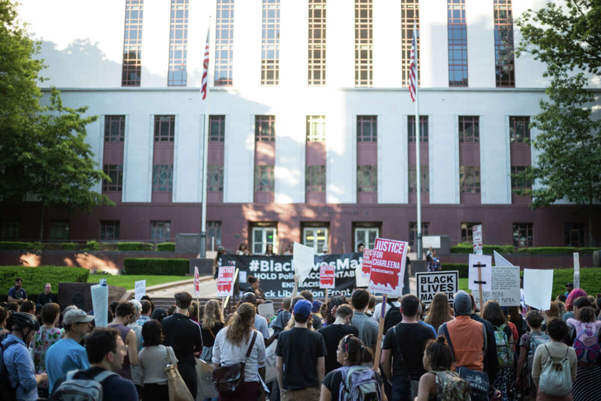 A rally protesting the recent police shooting and death of Charleena Lyles pauses in front of the U.S. Court of Appeals in downtown Seattle.