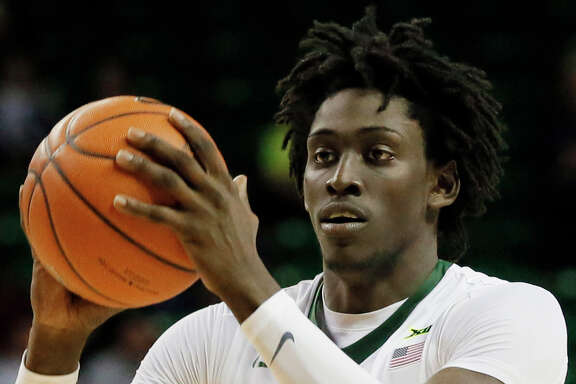 Baylor forward Johnathan Motley prepare to make a pass during an NCAA college basketball game against Oklahoma on Tuesday, Feb. 21, 2017, in Waco, Texas. (AP Photo/Tony Gutierrez)