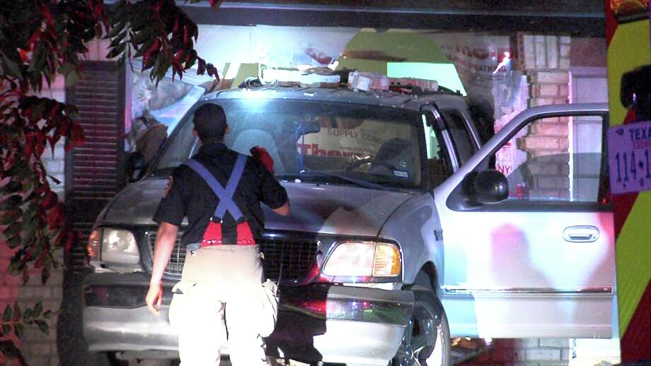 Police and paramedics responded to the scene around 3:50 a.m. on June 23, 2017, in the 10400 block of Aristocrat Street, where they found a Ford SUV halfway inside a home. Photo: Ken Branca