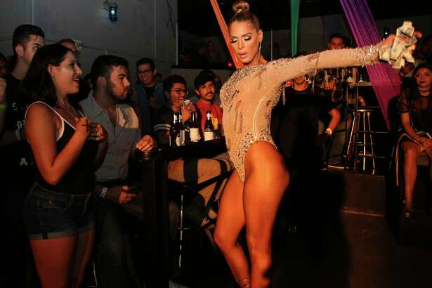 "Carmen Carrera - transgender superstar, activist and ""RuPaul's Drag Race"" contestant - interacts with audience while performing at a special edition of ""So You Think You Can Drag,"" a weekly amateur drag show, for Pride week at South Beach Thursday, June 22, 2017, in Houston."