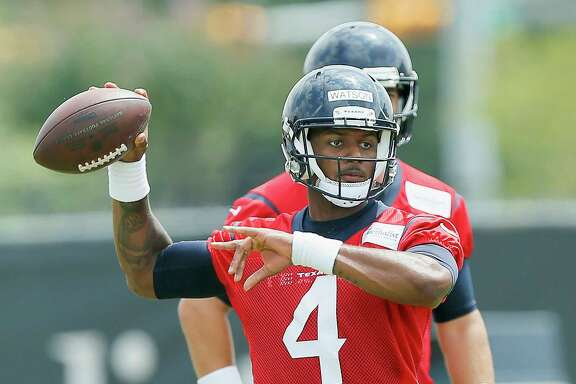 Houston Texans quarterback Deshaun Watson (4) throws a pass during the team's organized team activity at its NFL football training facility Wednesday, May 31, 2017, in Houston. (AP Photo/Bob Levey)