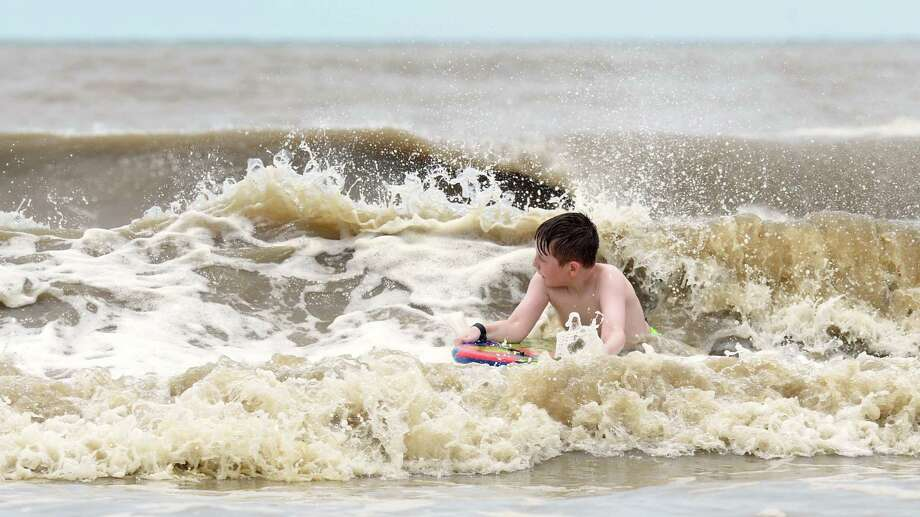 Ethan Gaspard rides a body board in the near Sabine Pass on Tuesday. Heavy winds and rain from Hurricane Cindy are expected to make landfall along the Gulf Coast later today or early Thursday.  Photo taken Tuesday, June 20, 2017 Guiseppe Barranco/The Enterprise Photo: Guiseppe Barranco, Photo Editor