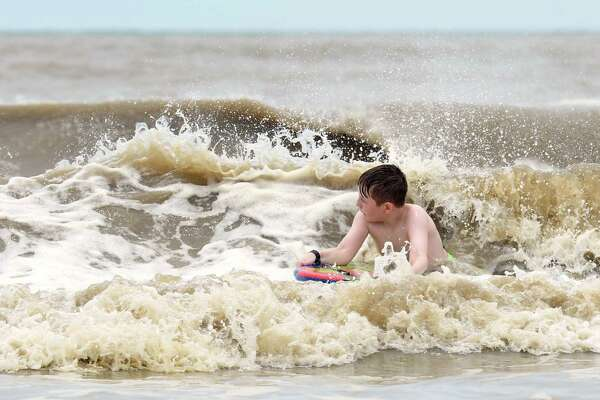 Ethan Gaspard rides a body board in the near Sabine Pass on Tuesday. Heavy winds and rain from Hurricane Cindy are expected to make landfall along the Gulf Coast later today or early Thursday.  Photo taken Tuesday, June 20, 2017 Guiseppe Barranco/The Enterprise
