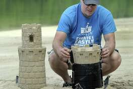 Kevin Lane of New Milford and his family invented a new system for building sand castles and snow sculptures. He demonstrates his system at Lynn Deming Park in New Milford, Thursday, June 22, 2017.