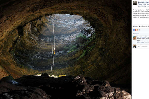 """Devil's Sinkhole State Natural Area : """"A view looking up out of Devil's Sinkhole. A researcher descends into the pit this past Saturday. There are no recreational trips into Devil's Sinkhole. All trips into the hole are performed by expert cavers for authorized scientific research."""""""