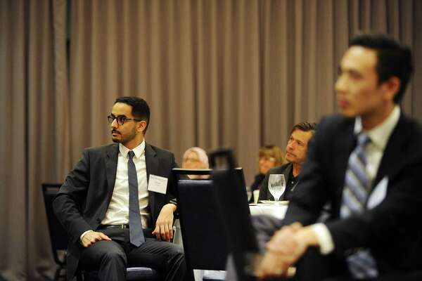 Albaraa Alyamani, a recent graduate of UConn's graduate risk management program, listens to presidential historian Douglas Brinkley give the keynote speech during the UConn Risk Management Conference at the Crowne Plaza Stamford hotel in Stamford, Conn. on Wednesday, June 21, 2017.