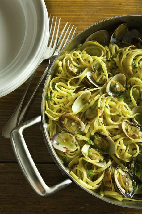 Linguine Alle Vongole (Linguine with Clams) is linguine with cooked Manila clams in their shells, olive oil, garlic, parsley and hot pepper. Photo: Courtesy CIA / Francesco Tonelli / © 2008 Francesco Tonelli - All Rights Reserved