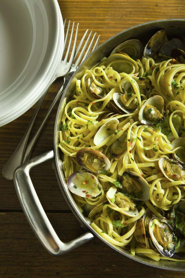 Linguine Alle Vongole (Linguine with Clams) is linguine with cooked Manila clams in their shells, olive oil, garlic, parsley and hot pepper.