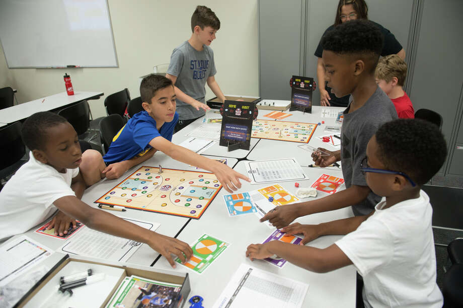 Participants in SIUE's We Got Game: NBA Math Hoops camp work together to enhance their math skills through interactive learning. Photo: For The Intelligencer
