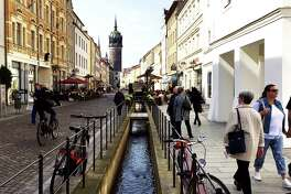 A stream trickles toward Castle Church, where Luther is said to have nailed his 95 theses to the door.