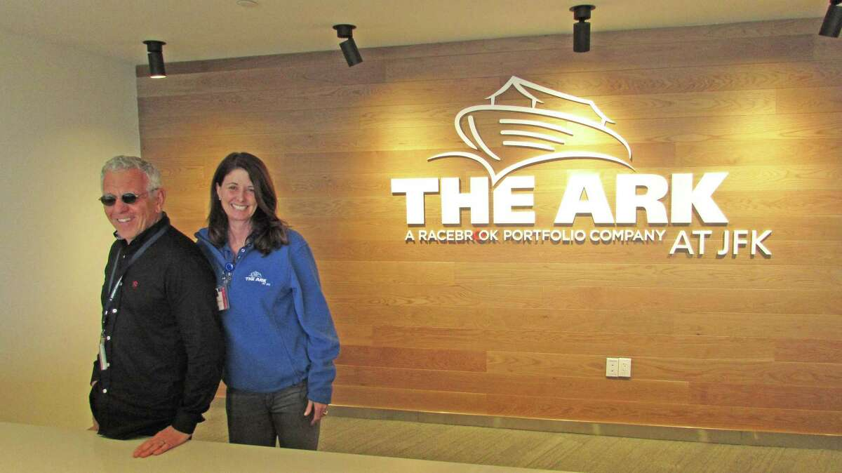 Greenwich residents John Cuticelli and his wife Elizabeth Schuette-Cuticelli pose at the front desk of the newly opened Ark, a multi-purpose animal handling and air cargo facility at New York?'s John F. Kennedy International Airport. The Ark covers more than 175,000 square-feet and has been developed as a portfolio company of New York City-based investment company Racebrook Capital, which the Greenwich couple own.