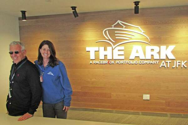 Greenwich residents John Cuticelli and his wife Elizabeth Schuette-Cuticelli pose at the front desk of the newly opened Ark, a multi-purpose animal handling and air cargo facility at New York's John F. Kennedy International Airport. The Ark covers more than 175,000 square-feet and has been developed as a portfolio company of New York City-based investment company Racebrook Capital, which the Greenwich couple own.