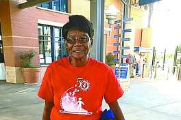 "Foster grandparent Helen Brown, or ""Granny Helen"" as she is known, with Melissa, a student at Midland College's Children Center, about to enjoy a Midland Rockhounds game."