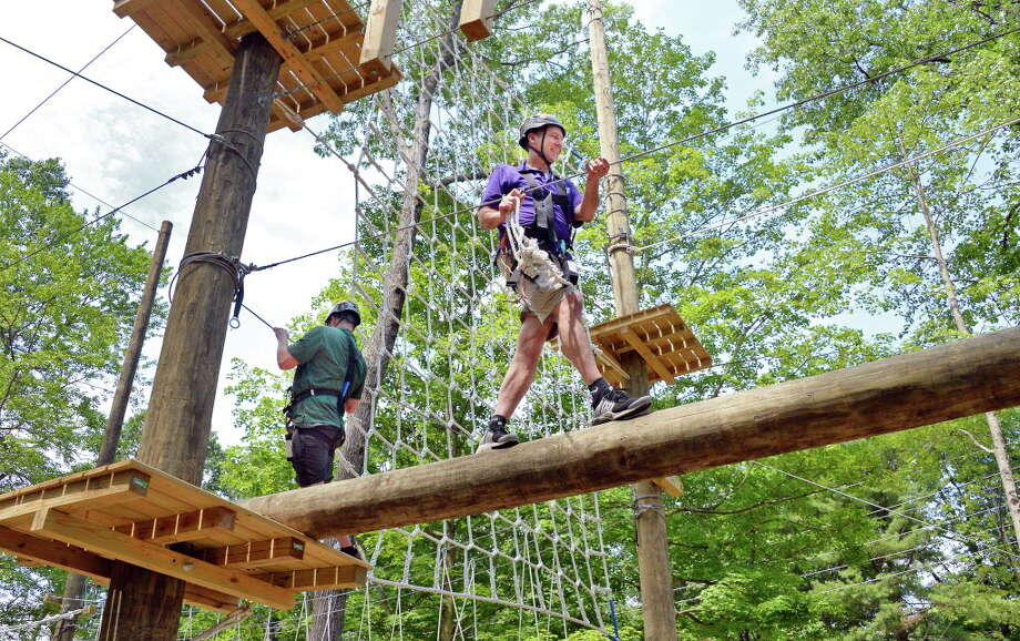 Outdoor Center facilitators Jerod Keech, left, and Chris Busold perform a safety inspection following the Grand Opening of the Saratoga Regional YMCA's Adventure Course at their Saratoga Springs Branch Friday June 23, 2017 in Saratoga Springs, NY.  (John Carl D'Annibale / Times Union) Photo: John Carl D'Annibale, Albany Times Union / 40040869A