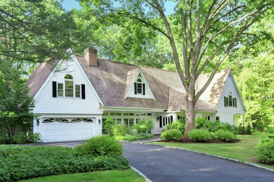 The colonial manor house at 25 Powder Horn Hill Road sits on a 2.79-acre level property in central Wilton, within walking distance of the New Haven Metro-North train station. Photo: /