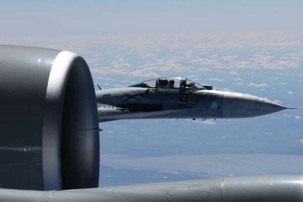 In this photo released by the Department of Defense, a U.S. RC-135U flying in international airspace over the Baltic Sea was intercepted by a Russian SU-27 Flanker June 19, 2017. Due to the high rate of closure speed and poor control of the aircraft during the intercept, this interaction was determined to be unsafe by the Department of Defense.