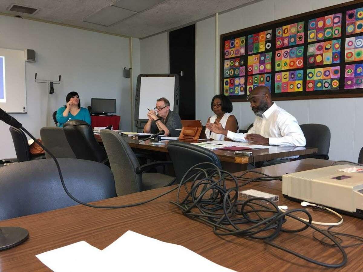 School board members Maria Pereira, Ben Walker, Sauda Baraka and Howard Gardner