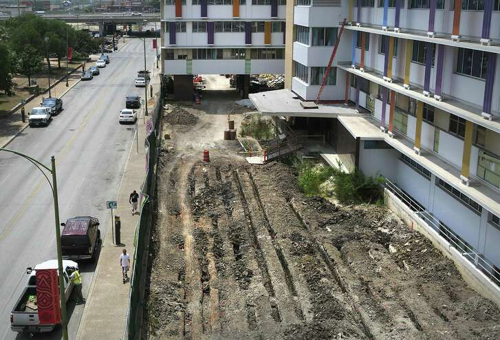 Christus Santa Rosa Health System says it will not restart removal of remains from 200-year-old cemetery beneath the Children's Hospital of San Antonio downtown.