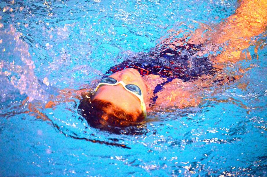 Water Works swimmer Avery Marsh competes in the fourth heat of the 25-meter backstroke in the 7-8 girls division in a dual meet against Splash City in Edwardsville.
