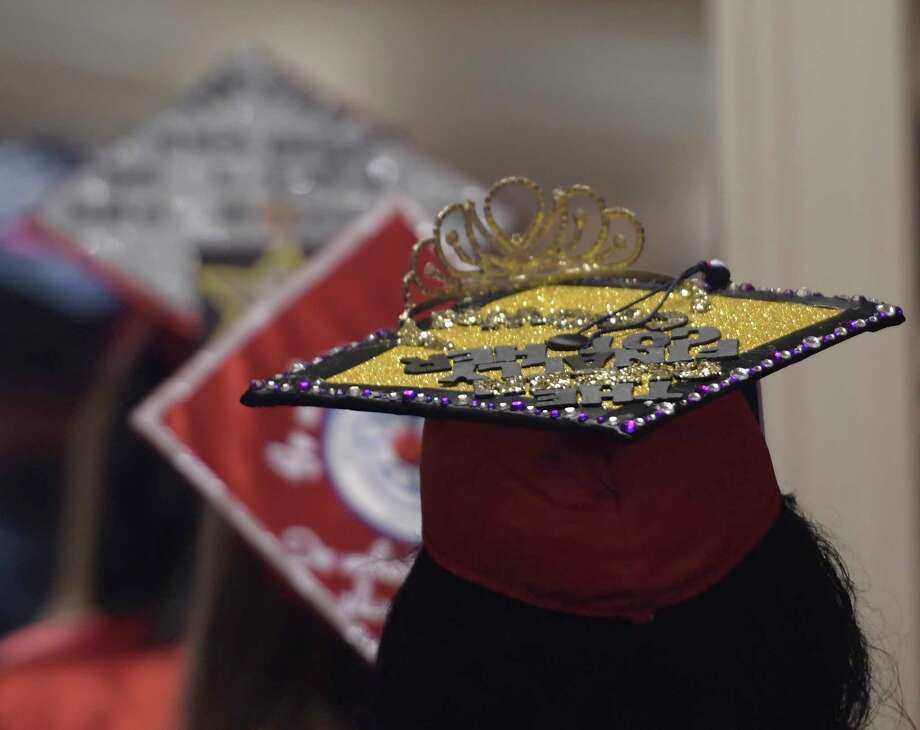 Creativity was evident as graduates decorated their caps and showed them off a the Schenectady High School graduation Friday June 23, 2017 held at Proctor's Theatre in Schenectady, N.Y.  (Skip Dickstein/Times Union) Photo: SKIP DICKSTEIN / 20040854A
